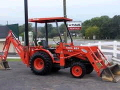Where to rent BACKHOE 4WD 20HP 16  BUCKET in Denver NC